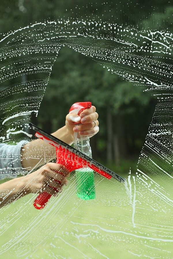 Squeegee being used on a window