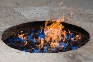 fire pit with flames in garden