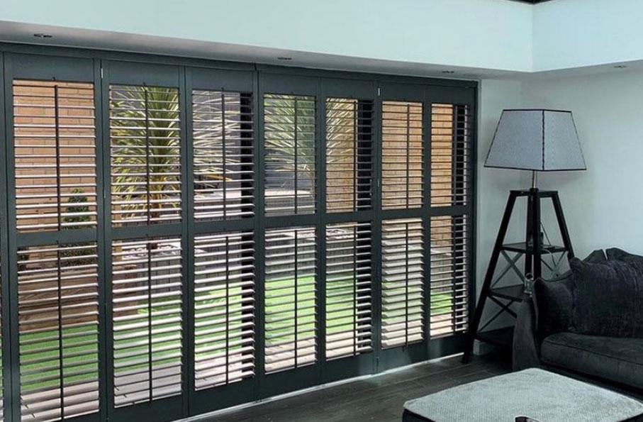 tracked shutter installation in living room