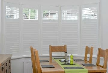 dining-room-interior-woth-wooden-bay-window-shutter