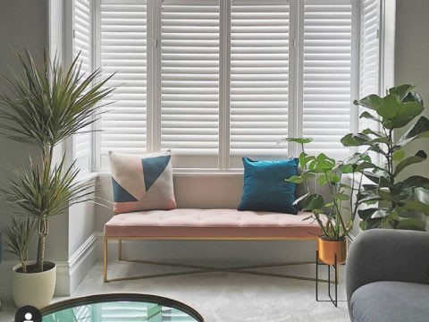 bay window shutters installation in living room