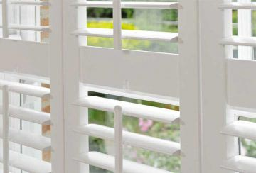 white-wooden-window-shutters