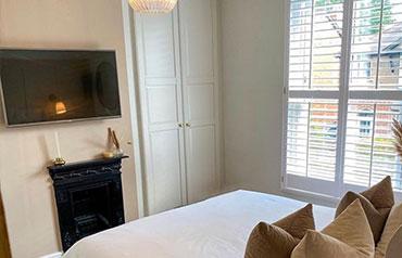 shutters installation in bedroom