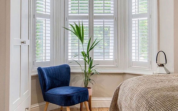 bay window shutter with seat and plant